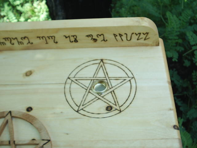 Two pentacles with candle holders included on the top of this wiccan altar
