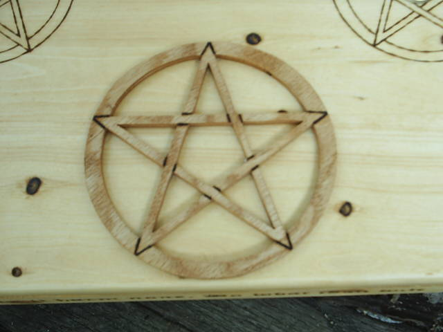 Scrolled pentacle mounted on the wiccan altar top for focus and magic spell casting